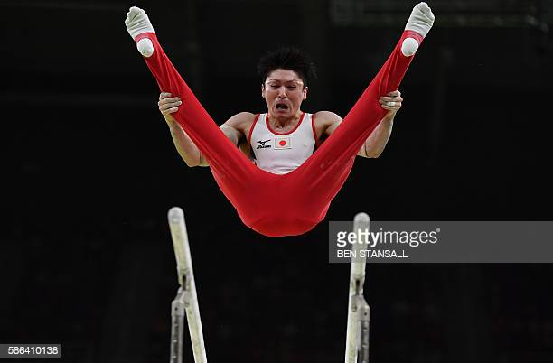 Japan's Kohei Uchimura competes in the qualifying for the men's parallel bars event of the Artistic Gymnastics at the Olympic Arena during the Rio...
