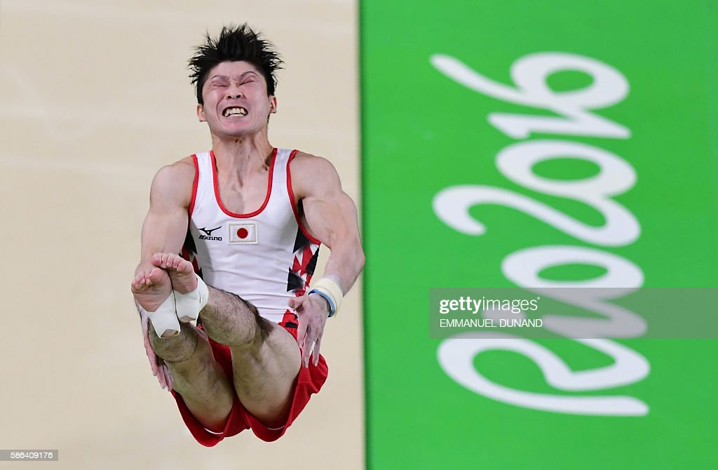 TOPSHOT - Japan's Kohei Uchimura competes in the qualifying for the men's vault event of the Artistic Gymnastics at the Olympic Arena during the Rio 2016 Olympic Games in Rio de Janeiro on August 6, 2016. / AFP / Emmanuel DUNAND