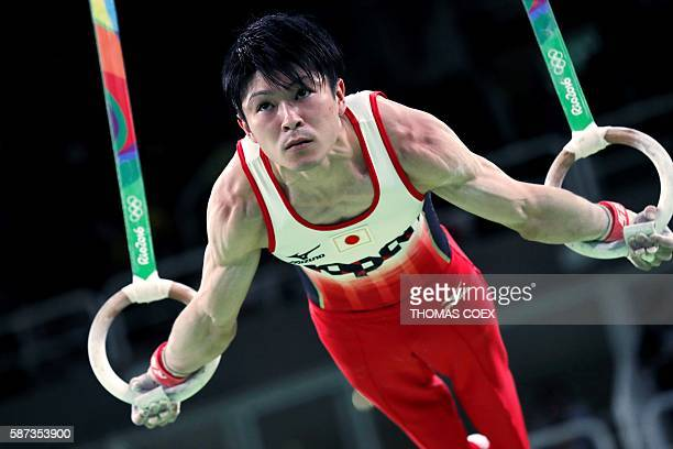 TOPSHOT Japan's Kohei Uchimura competes in the rings event of the men's team final of the Artistic Gymnastics at the Olympic Arena during the Rio...