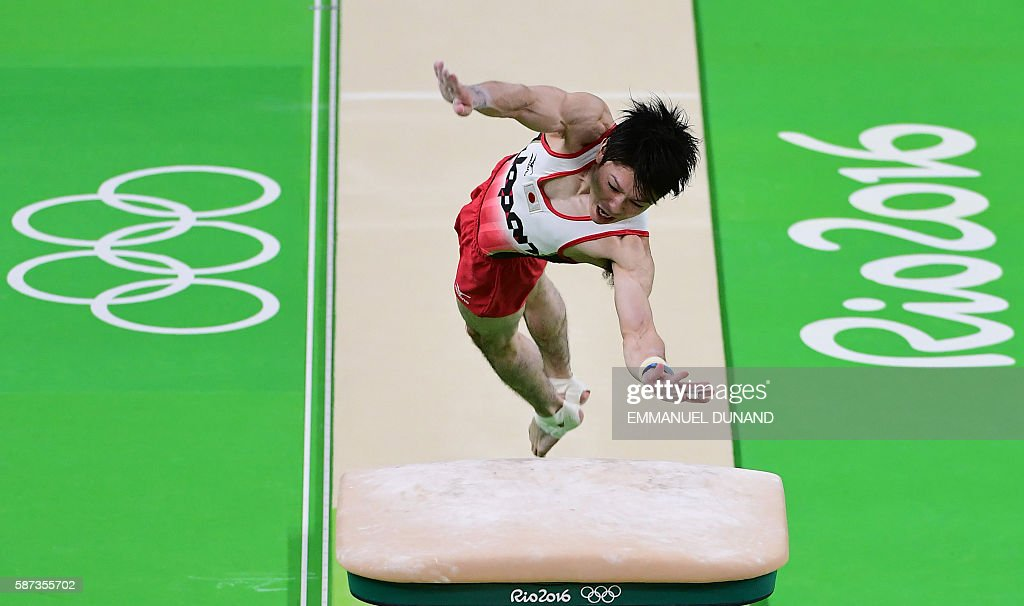 TOPSHOT - Japan's Kohei Uchimura competes in the vault of the men's team final of the Artistic Gymnastics at the Olympic Arena during the Rio 2016 Olympic Games in Rio de Janeiro on August 8, 2016. / AFP / Emmanuel DUNAND