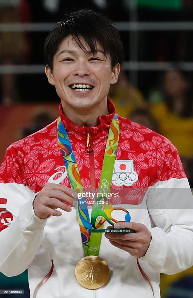 Japan's Kohei Uchimura poses with his gold medal on the podium of the men's team final of the Artistic Gymnastics at the Olympic Arena during the Rio 2016 Olympic Games in Rio de Janeiro on August 8, 2016. / AFP / Thomas COEX