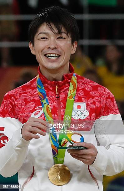 Japan's Kohei Uchimura poses with his gold medal on the podium of the men's team final of the Artistic Gymnastics at the Olympic Arena during the Rio...