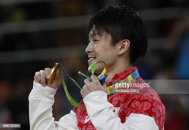 Japan's Kohei Uchimura poses with his gold medal on the podium of the men's individual allaround final of the Artistic Gymnastics at the Olympic...