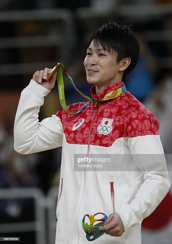 Japan's Kohei Uchimura poses with his gold medal on the podium of the men's individual all-around final of the Artistic Gymnastics at the Olympic Arena during the Rio 2016 Olympic Games in Rio de Janeiro on August 10, 2016. / AFP / Thomas COEX