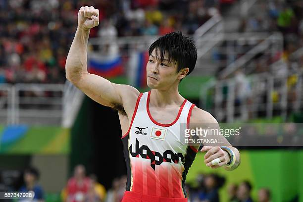 Japan's Kohei Uchimura reacts after competing in the pommel horse event of the men's team final of the Artistic Gymnastics at the Olympic Arena...