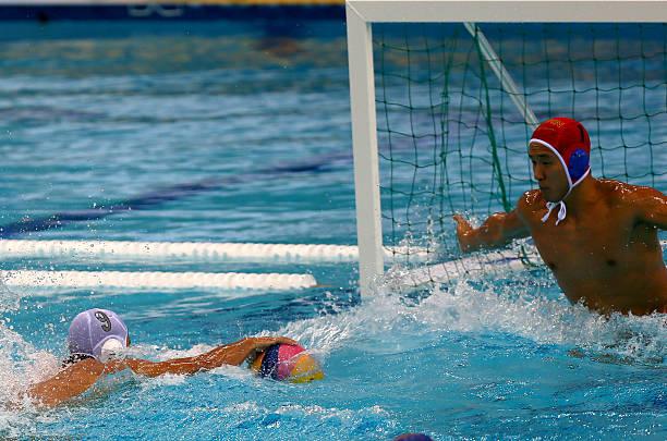 Japan's Koji Takei (L) tries to score against China's