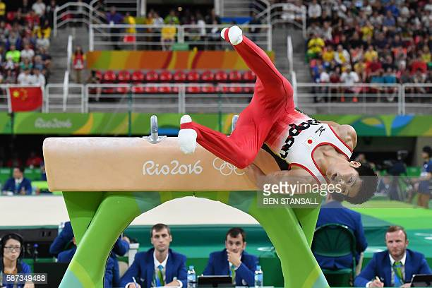 TOPSHOT Japan's Koji Yamamuro falls from the pommel horse during the men's team final of the Artistic Gymnastics at the Olympic Arena during the Rio...