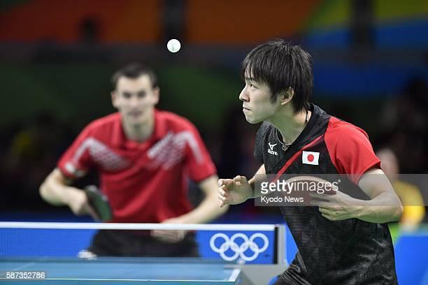 Japan's Koki Niwa faces off against Stefan Fegerl of Austria during their men's singles third-round table tennis match at the Rio de Janeiro Olympics...