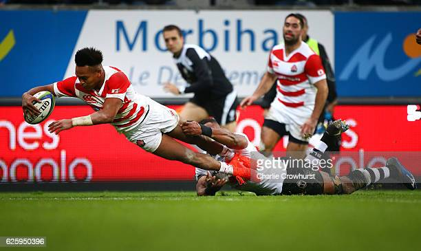 Japan's Kotaro Matsushima dives over the line to score a try during the International match between Japan and Fiji at Stade de la Rabine on November...