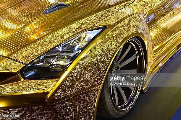Japan's Kuhl racing and arts displays a custom car Project R35GTR painted with gold metal paint and 3D diamond block on the Nissan GTR at Tokyo Auto...