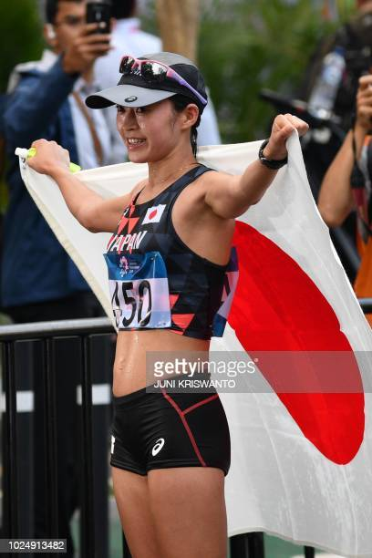 Japan's Kumiko Okada celebrates after finishing third in the women's 20km walk race competition during the 2018 Asian Games in Jakarta on August 29...