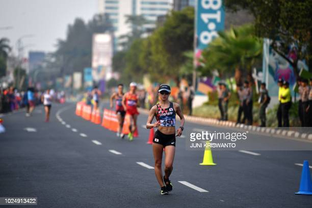 Japan's Kumiko Okada competes in the women's 20km walk race competition during the 2018 Asian Games in Jakarta on August 29 2018