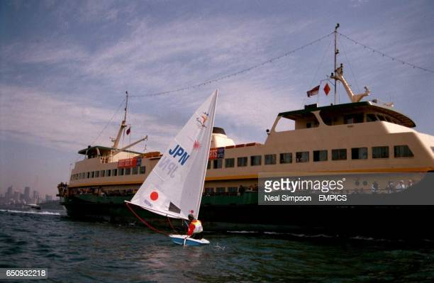 Japan's Kunio Suzuki narrowly avoids a collision with a ferry crossing Sydney Harbour