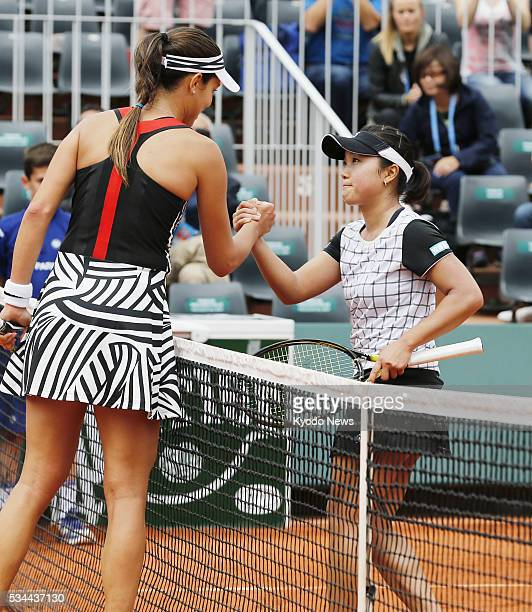 Japan's Kurumi Nara and Ana Ivanovic of Serbia shake hands following their women's singles secondround match at the French Open tennis championships...