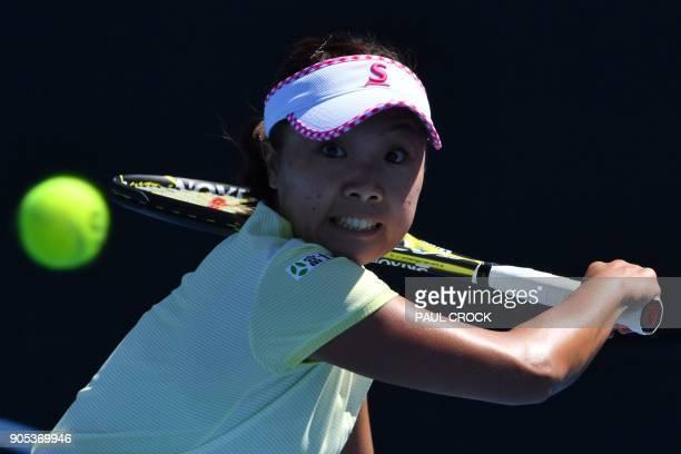 Japan's Kurumi Nara hits a return against Czech Republic's Marketa Vondrousova during their women's singles first round match on day two of the...
