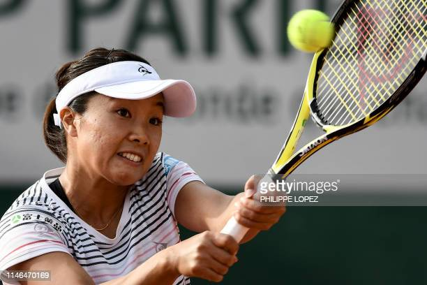 Japan's Kurumi Nara plays a backhand return to Slovenia's Dalila Jakupovic during their women's singles first round match on day two of The Roland...