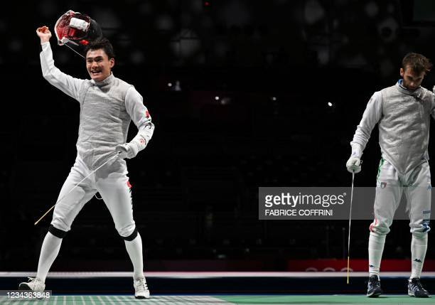 Japan's Kyosuke Matsuyama celebrates after winning against Italy's Daniele Garozzo in the mens team foil quarter-final bout during the Tokyo 2020...