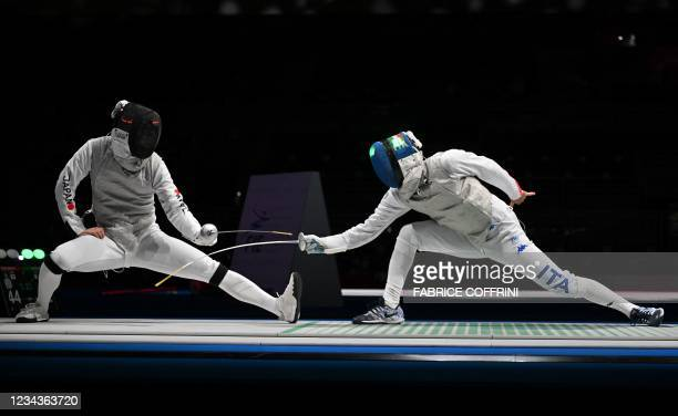 Japan's Kyosuke Matsuyama compete against Italy's Daniele Garozzo in the mens team foil quarter-final bout during the Tokyo 2020 Olympic Games at the...