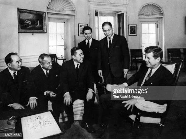 Japan's Liberal Democratic Party politician Eisaku Sato talks with US President John F Kennedy at the White House on October 18 1962 in Washington DC