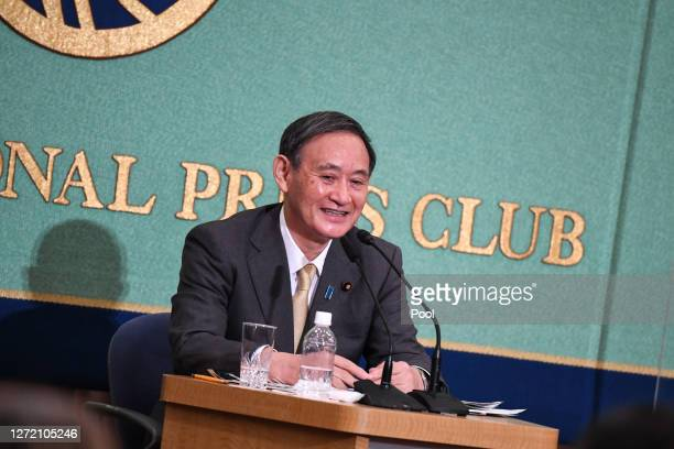 Japan's Liberal Democratic Party's leadership election candidate Chief Cabinet Secretary Yoshihide Suga speaks during a debate ahead of the Liberal...