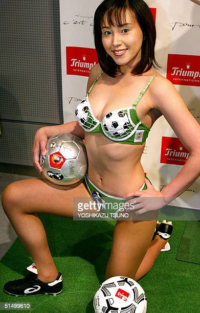 Japan's lingerie maker Triumph International Japan campaign girl Anri Takao displays the 'Hat Trick Bra' motifed by soccer goal nets and balls for...