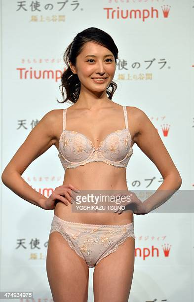 Japan's lingerie maker Triumph International Japan campaign model Eri Oishi displays the company's 'Angel Bra' in Tokyo on February 26 2014 The...