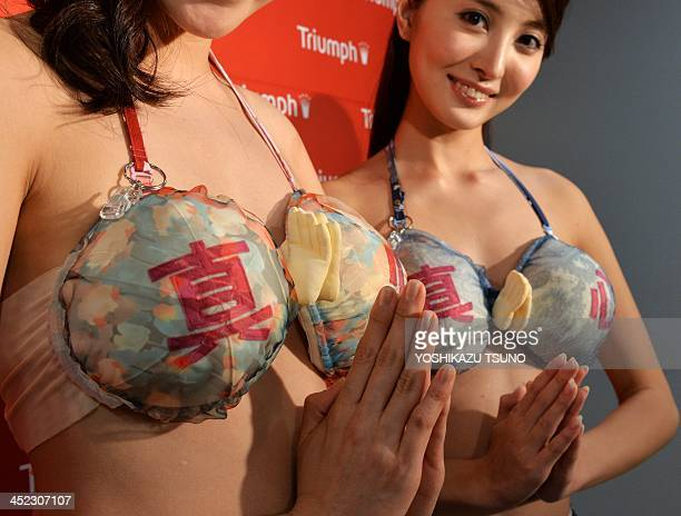 Japan's lingerie maker Triumph International Japan campaign models Ai Takahara and Eri Oishi display the company's new unique bra 'Omotenashi Compact...