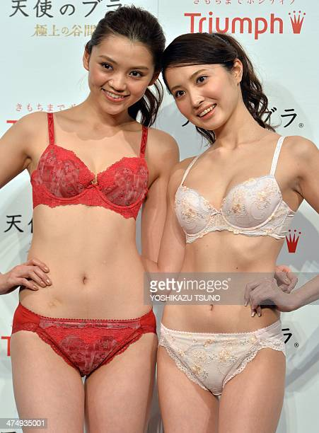 Japan's lingerie maker Triumph International Japan campaign models Ai Takahara and Eri Oishi display the company's 'Angel Bra' in Tokyo on February...