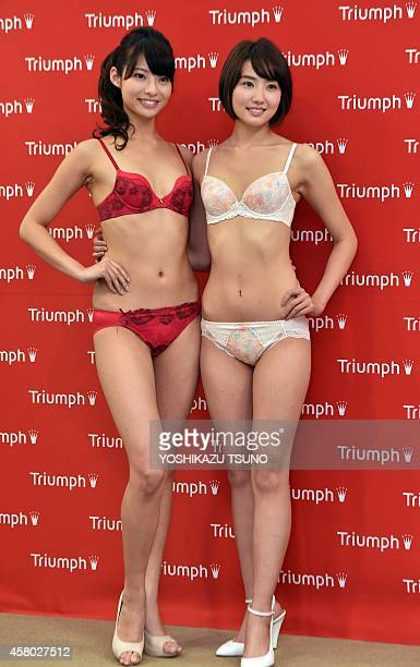 Japan's lingerie maker Triumph International Japan campaign models Reina Nagata and Eri Kamataki pose for photo as they are announced for the new...