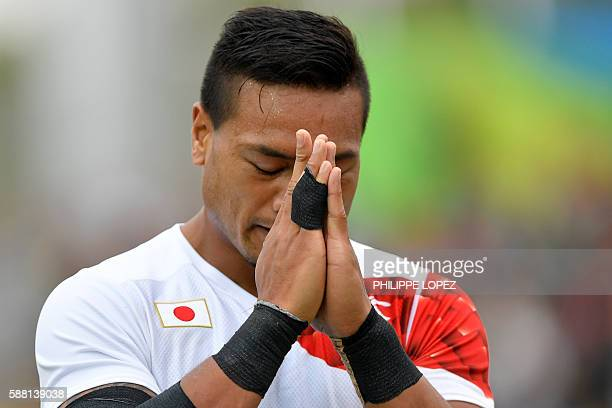 TOPSHOT Japan's Lomano Lemeki celebrates scoring a try in the mens rugby sevens match between Kenya and Japan during the Rio 2016 Olympic Games at...