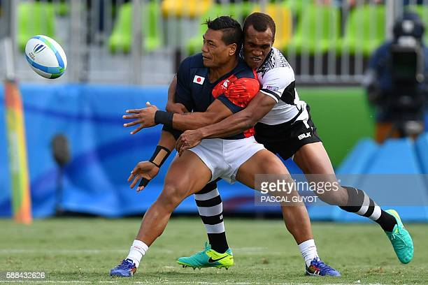 TOPSHOT Japan's Lomano Lemeki is tackled in the mens rugby sevens semifinal match between Fiji and Japan during the Rio 2016 Olympic Games at Deodoro...