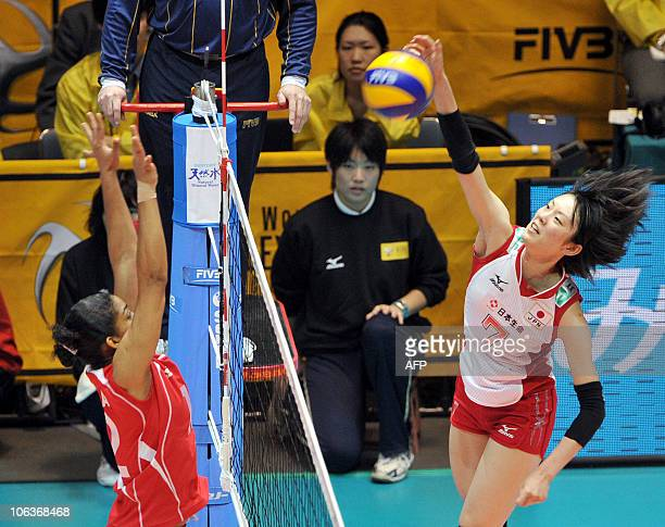 Japan's Mai Yamaguchi spikes the ball against Peru's Carla Rueda during the 1st round of the world woman's volleyball Championship in Tokyo on...