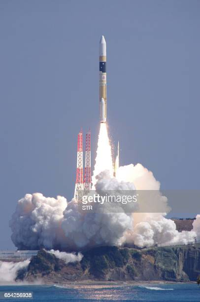 Japan's main H2A rocket lifts off from its launching pad to carry an informationgathering satellite Radar 5 onto orbit at the Tanegashima Space...