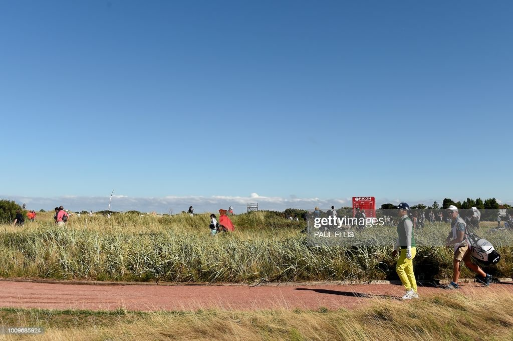 Japan's Mamiko Higa leaves the 16th tee on the first day of the 2018 Women's British Open Golf Championships at Royal Lytham & St. Annes Golf Club, northwest England, on August 2, 2018.