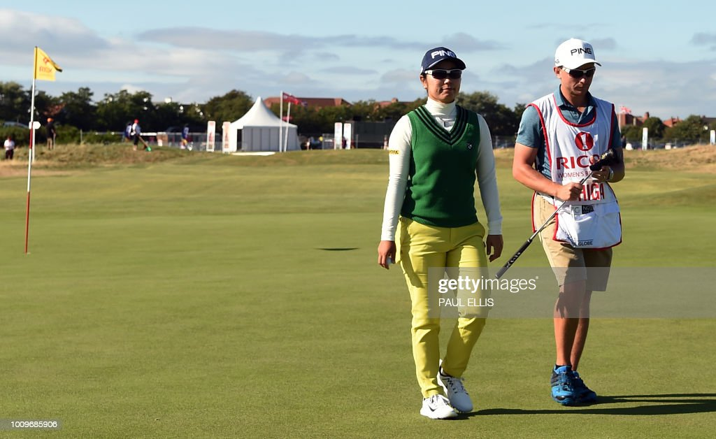 Japan's Mamiko Higa leaves the 17th green on the first day of the 2018 Women's British Open Golf Championships at Royal Lytham & St. Annes Golf Club, northwest England, on August 2, 2018.