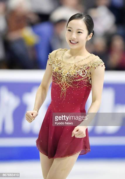 Japan's Marin Honda smiles after performing in the women's singles free program at Skate Canada International at Brandt Center in Regina Canada on...