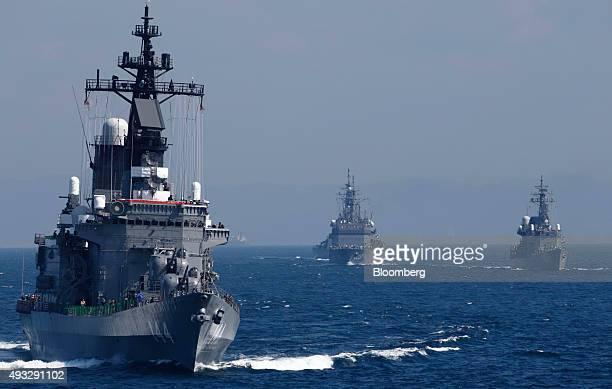 Japan's Maritime Self-Defense Force destroyer ship Kurama, left, leads a troop of vessels during a fleet review at Sagami Bay, off Yokosuka, Kanagawa...
