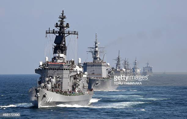 Japan's Maritime Self-Defense Force escort ship Kurama sails with other ships during a fleet review off Sagami Bay, Kanagawa prefecture, on October...