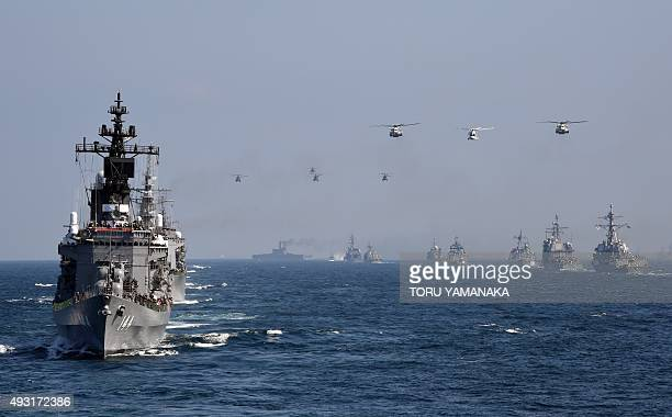 Japan's Maritime Self-Defense Force escort ship Kurama takes part in a fleet review off Sagami Bay, Kanagawa prefecture, on October 18, 2015....
