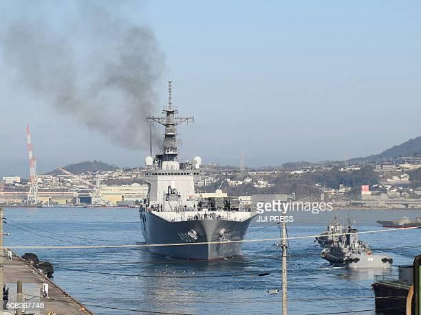 Japan's Maritime Self-Defense Force transport vessel Oosumi , carrying ground-based ballistic missile interceptors, leaves the MSDF base in Kure,...