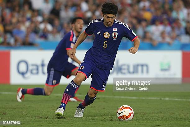 Japan's Masato Morishige clears the ball from UAE's Ali Ahmed Mabkhout at Stadium Australia Sydney Australia Friday 23rd January 2015