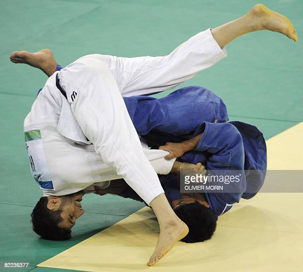 Japan's Masato Uchishiba and Iran's Arash Miresmaeili compete during their men's 66kg match of the 2008 Beijing Olympic Games on August 10 2008 in...
