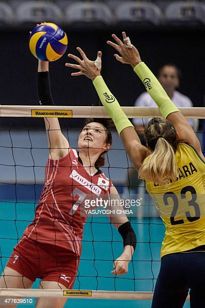 Japan's May Yamaguchi attacks agaisnt Brazil's Barbara Bruch during their volleyball friendly match at Maracanazinho Arena in Rio de Janeiro Brazil...