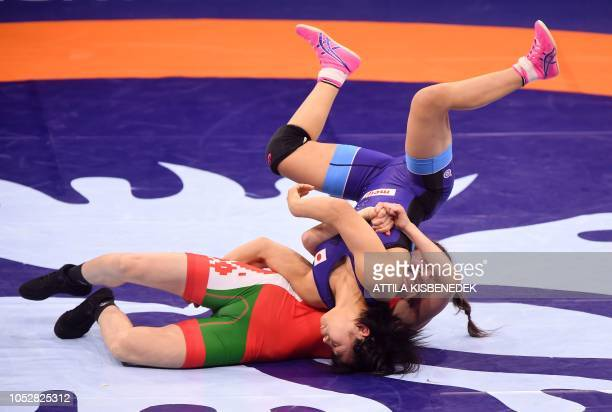 Japan's Mayu Mukaida and Belarus' Zalina Sidakova compete during the final of women's freestyle wrestling 55kg category at the World Wrestling...