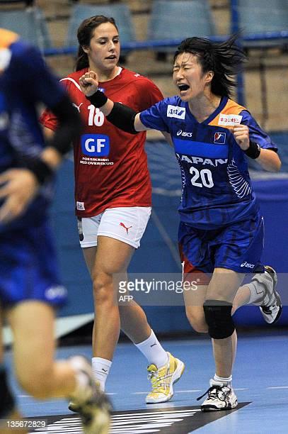 Japan's Mayuko Ishitate celebrates after making a goal against Denmark during their Women's World Handball Championship match in Sao Bernardo do...