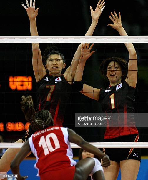 Japan's Megumi Kurihara and Sachiko Sugiyama block a smash by Venezuela's Jayce Andrade during a women's volleyball preliminary match of the Beijing...