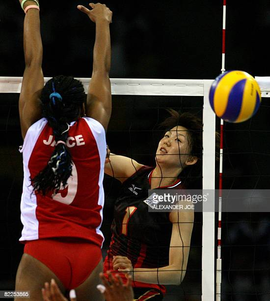 Japan's Megumi Kurihara slams the ball past Venezuela's Jayce Andrade during a women's volleyball preliminary match of the Beijing 2008 Olympic Games...