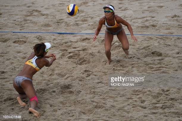 Japan's Megumi Murakami and Miki Ishii compete against China in the women's beach volleyball final during the 2018 Asian Games in Palembang on August...