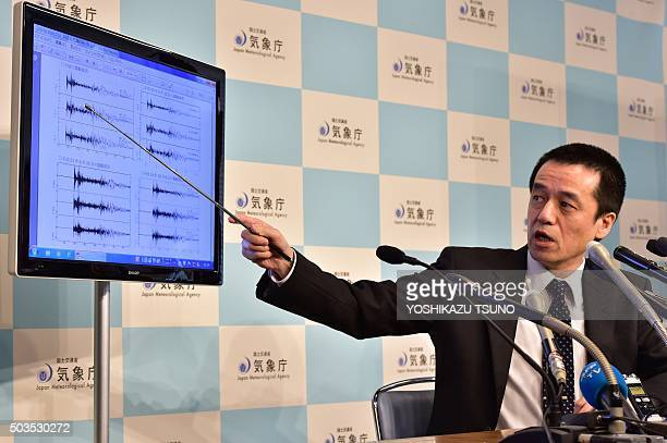Japan's meteorological agency officer Yohei Hasegawa displays a chart showing seismic activity after a North Korean nuclear test at the agency in...