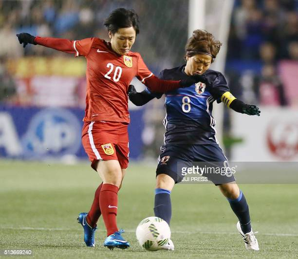 Japan's midfielder Aya Miyama and China's midfielder Zhang Rui fight for the ball during their women's Asian qualifier football match for the Rio de...